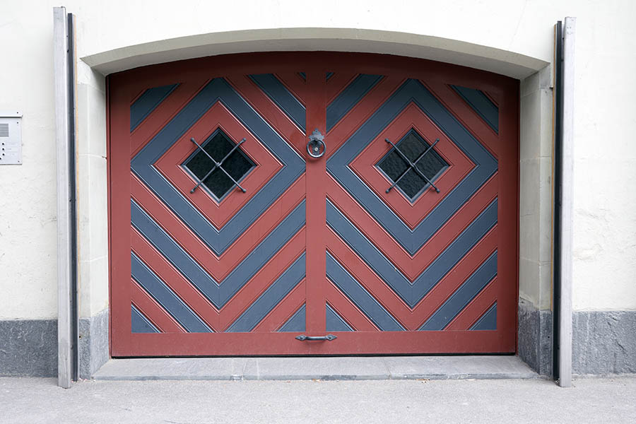 Photo 23875: Formed, red and blue garage door with barred, diamond-shaped door lights