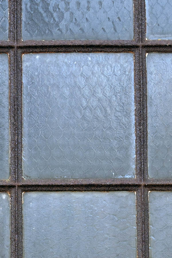Photo 08224: Rusty, brown metal window with 16 panes
