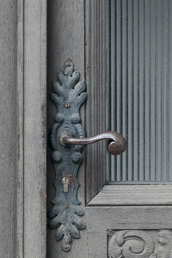 Photo 11859: Worn, carved, panelled, unpainted double door with door lights