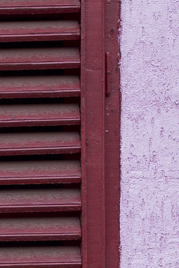 Photo 25782: Window with red, formed shutters in a pink wall